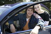 photo: teenage boy and girl with a car
